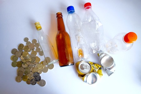 bottles can money with white background