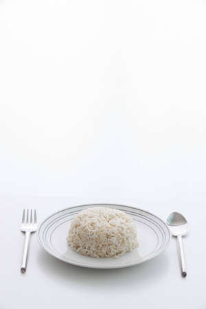 Brown rice with dish , spoon , fork photo