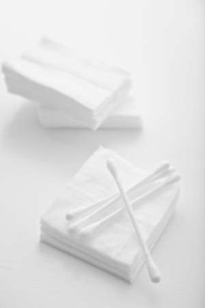 cotton sheet and cotton buds in white background photo