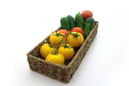 cuke: Yellow tomatos, red tomato, cuke, basket