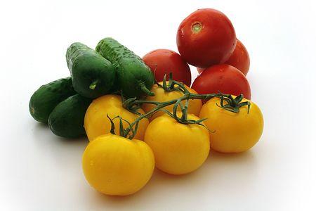 Yellow tomatos, red tomatos, cucumbers