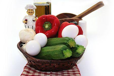Components for an omelette: vegetable, marrows, pepper, eggs, garlic, oil. Reklamní fotografie