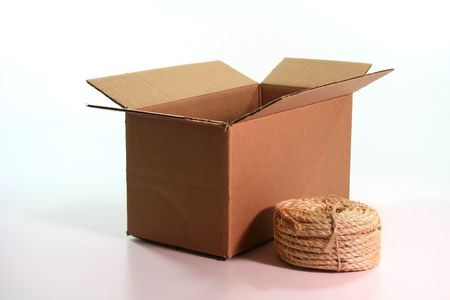 Cardboard box with a hank of a cord for linkage. Stock Photo - 5383710