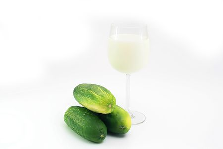 The combination of a crude cucumber and fresh milk leads to diarrhoeia. In a photo three cucumbers and a milk glass. Stock Photo - 5472632