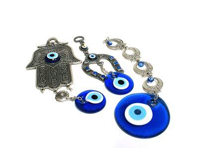 affix: Human blue Eye amulet with icon and israel hamsa keyring. Stock Photo