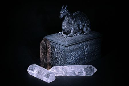 predictions: The casket on which cover lies a dragon and before a casket crystals for predictions lie. Stock Photo