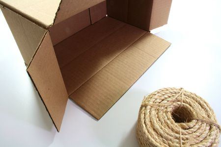 hank: Cardboard box with a hank of a cord for linkage.