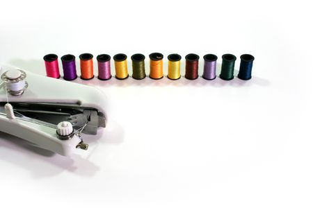 Overlocker and a set of coils with colour threads. Stock Photo - 5533575
