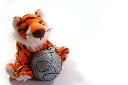 Soft toy a tiger and ball - a symbol of 2010 on east calendar.