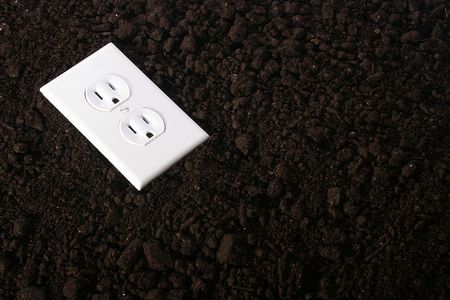 source: The electric socket against a ground - a symbol of an alternative energy source.
