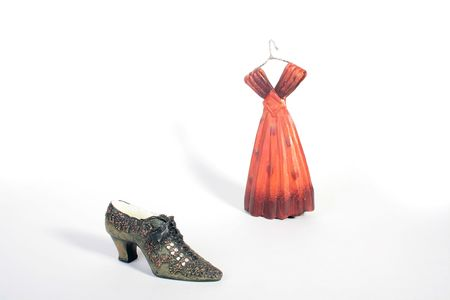 Ceramic shoe and dress for decorative registration of houses, offices in the fashion industry.