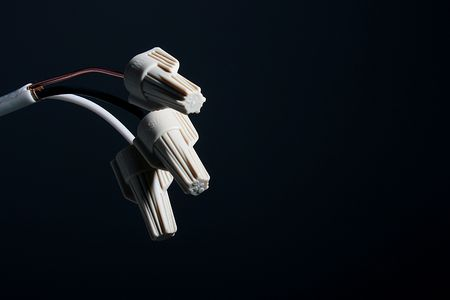 threefold: Threefold wire with insulation plug. On insulation plug not a logo, and the information on electric check and conformity. Stock Photo
