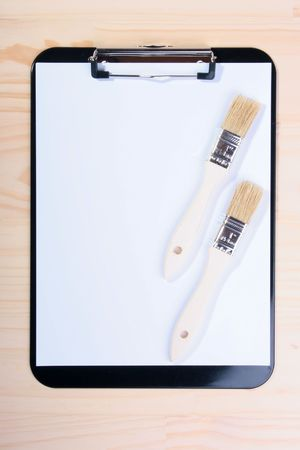 Two brushes are located on blank clipboard