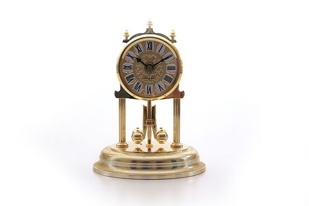 pendulum: Hours with a rotating pendulum of yellow metal.