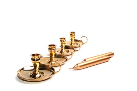 candle holder: Four small candlesticks on a white background and two gold candles for them.