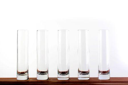 Five empty high narrow glasses on white background Stok Fotoğraf