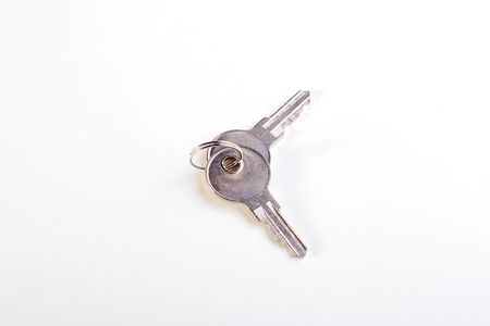 doorlock: Two keys on a ring for a door-lock on a white background.