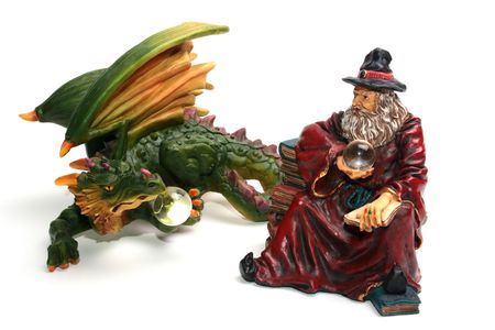 Ceramic figures of a dragon and the wizard on a white background. Stock Photo