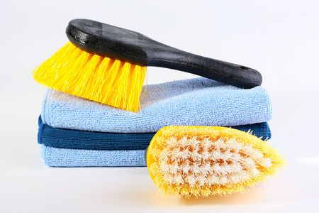 tonality: Two brushes for cleaning of a premise and a set of soft rags in a dark blue tonality.
