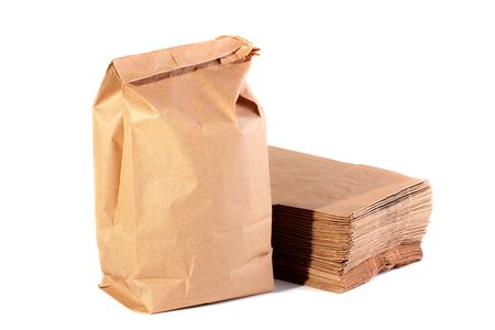 Paper packages for the dinners, one of packages with meal, the others a pile are combined on a background.