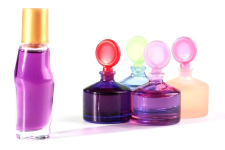 Small bottles with cosmetics for care of a face skin and hands. photo