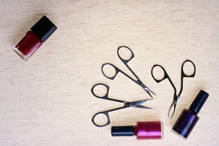 nail polish bottle: The special tool for care of nails with a small bottle red a varnish against from a fabric.