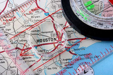 USA map with the city of Houston and a compass with magnifying glass over Houston. Stock Photo