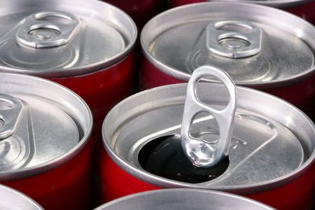Aluminium containers for soda water, beer or the juice, one bank it is opened. Stock Photo - 6292327