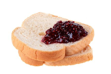 Two white slices of bread, on the top jam of red colour lies. Reklamní fotografie