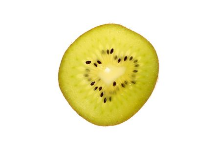 shined: The thin cut of a tropical fruit kiwi, is shined on a gleam.
