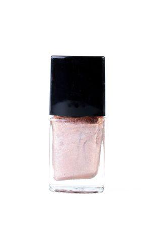 ピンクのマニキュアと小瓶はマニキュアの過程で使用されます。 写真素材
