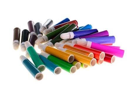 Markers for design and office works are poured out on a white table. Stock Photo - 6430348