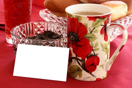 Tea with a roll and jam with an empty card for messages.