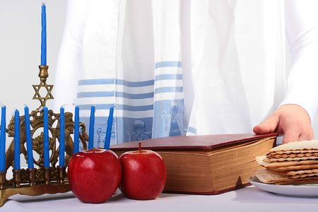 The Jewish theme, tallith katan - in the form of a cape with brushes, apples, a minor and the religious book. Stock Photo - 6499358