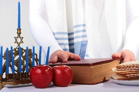 The Jewish theme, tallith katan - in the form of a cape with brushes, apples, a minor and the religious book. Stock Photo - 6547411
