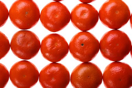 Tangerines are combined abreast and make a background.