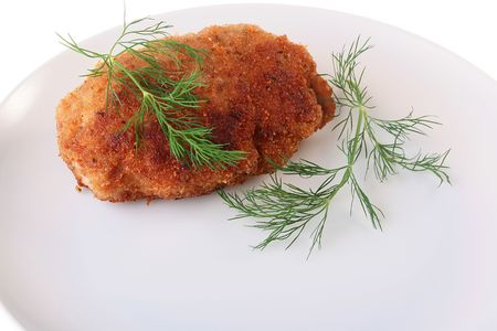 Ready cutlet are laid out on a white plate with a fennel branch. Stok Fotoğraf