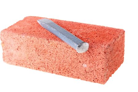 Building brick from red clay with a chisel. Banque d'images