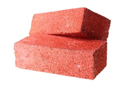 Building bricks from red clay on a white background. Stok Fotoğraf