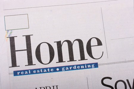articles: Heading Home of the multipage Sunday newspaper. The newspaper is printed on a cheap paper with polygraphic marriage