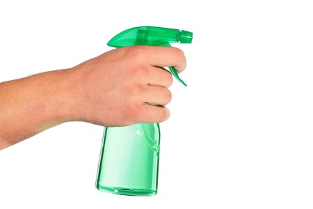 The mans hand holds a spray for water dispersion.