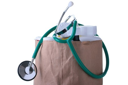 Medicines are combined in a paper package, the stethoscope from above lies. Stock Photo - 7029666