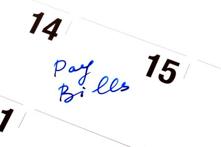 In a calendar the daily log record Pay Bills, as a reminder on necessary payments. photo