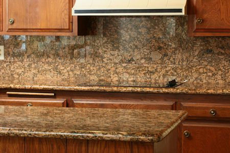 Granite covering for a working surface and an electric plate, a kitchen table. Stock Photo - 7151618