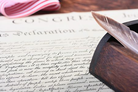 The ancient text of the declaration on independence of the United States of America with a casket and a feather for the write. Stock Photo - 7151616