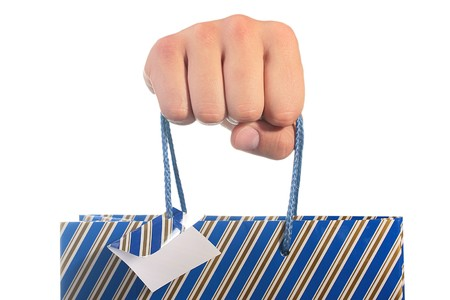 The mans hand holds a cardboard package for gifts.