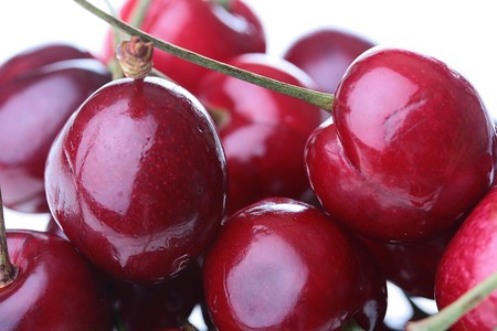 Ripe berries of a cherry of red colour with quicksets. Stock Photo