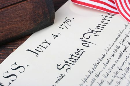 The declaration of Independence of the USA, celebratory ribbon and old casket. Stock Photo - 7265203