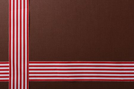 Brown background with two red-white tapes for design works.