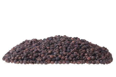 Black pepper not ground on a white background. 版權商用圖片